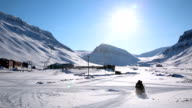 Several snowmobile ride through the snow-covered field in the far north. video