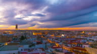 seville beautiful sunset city panorama from the roof top 4k time lapse spain video