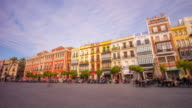 seville sunny day tourist square panorama with scooter and cafe 4k time lapse spain video