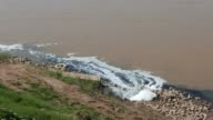 Sewage drains unthreated polluted waters into the Mekong River, Thailand, South East Asia. video