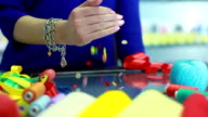 Sewing buttons falling on glass table. Sewing shop. Sewing supplies video