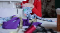 Sewing clothing close up shot video