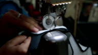 sewing in slow motion video