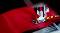 Sewing needle stitching seam on fabric in slow motion . Sewing machine in action video