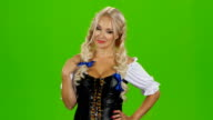 Sexy bavarian girl playing with her hair. Green screen video