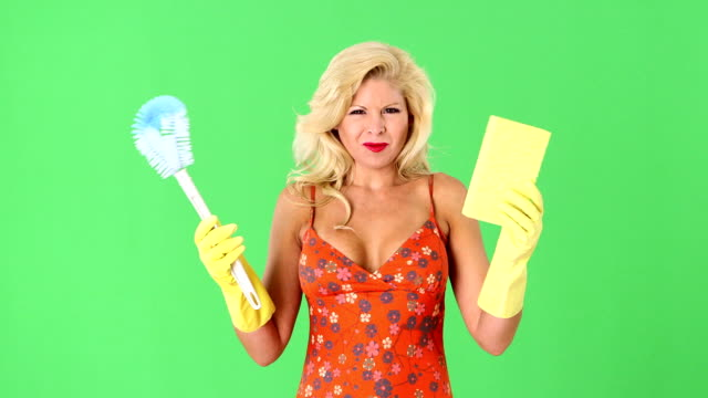 Sexy blonde woman with toilet bowl brush and sponge video
