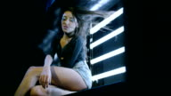 Sexy brunette girl dancing, Laying on cube. Shot on RED EPIC DRAGON Cinema Camera in slow motion. video