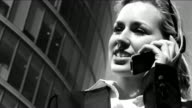 Sexy businesswoman on mobile video