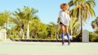 Sexy Flexible Girl Doing Splits on Roller Skates video