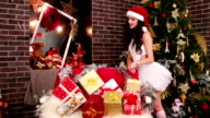 sexy girl a lot of Christmas gifts video