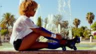 Sexy Girl Adjusting Her Roller Skates video