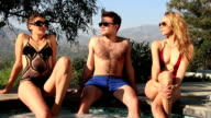 Sexy guy in sunglasses sizes up his women video