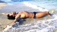HD SUPER SLOW MO: Sexy Man Lying On The Beach video