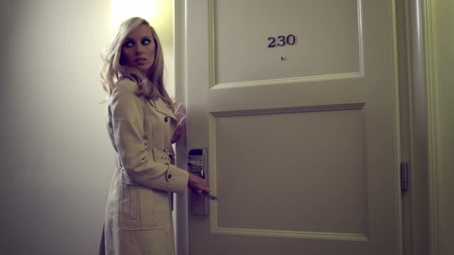 Sexy woman opens door video