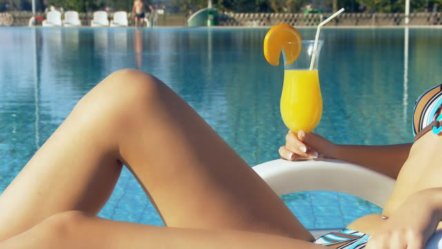HD DOLLY: Sexy Woman Relaxing By The Pool video
