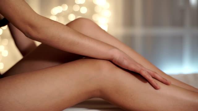 Sexy woman stroking leg video
