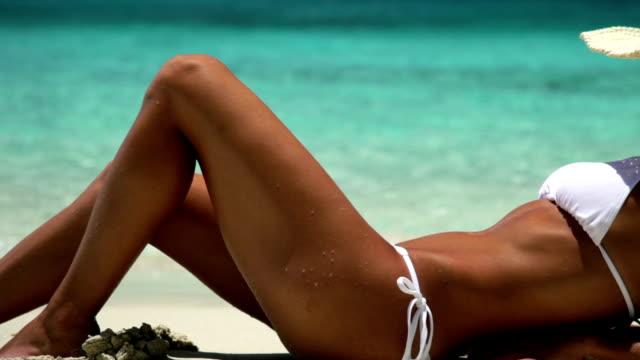 sexy woman sunbathing at a tropical Caribbean beach video