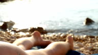 HD DOLLY: Sexy Woman Sunbathing On Mediterranean Beach video