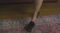 HD CRANE: Sexy woman walks in and lays down video