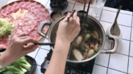 Shabu suki , Swirl slice pork in the hot pot , Bangkok , Thailand video