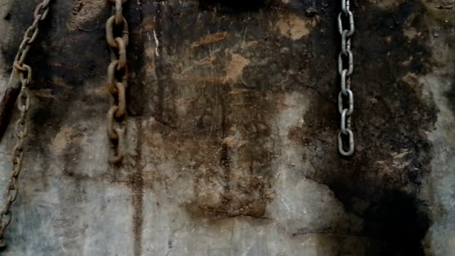 shackles and chains hanging on a wall video
