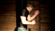 Shadow Boxing - young man is training in mixed martial arts hall video