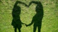 Shadows make a heart over grass video