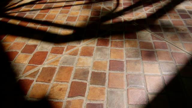 Shadows on terrace ceramic tiled floor in sunny day video