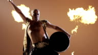Shaman dancing with a drum on grey background. Slow Motion. video