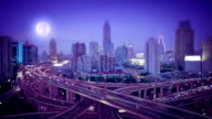Shanghai elevated road junction and interchange overpass at night, video