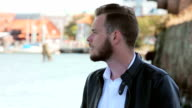 Sharp mature man standing near the water video