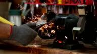 Sharpening a Axe Wood Splitter on a Grinder video