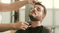 Shaving a client with trimmer video