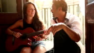 She plays guitar and sing for him video