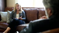 She wipes away tears as therapist listens video