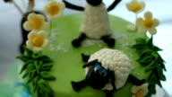 Sheep decorating a birthday cake video