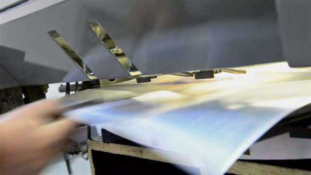 Sheet pulled from offset printing press. video