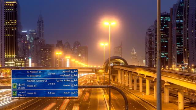 Sheikh Zayed road traffic day to night timelapse and Dubai Metro. Dubai, UAE video