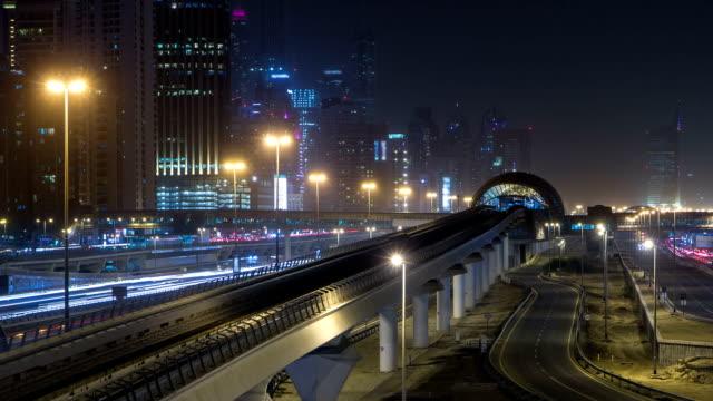 Sheikh Zayed road traffic night timelapse and Dubai Metro. Dubai, UAE video