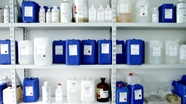 Shelf full of chemicals in plastic containers video