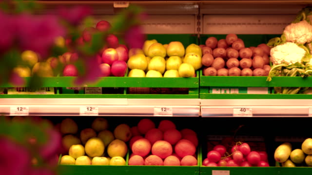 Shelves with fruits in super market video