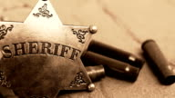 Sheriff badge and bullet cases on stone. video