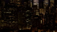 AERIAL: Shining skyscrapers and office buildings in downtown Manhattan at night video
