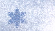 shiny blue christmas snowflake on defocused background video