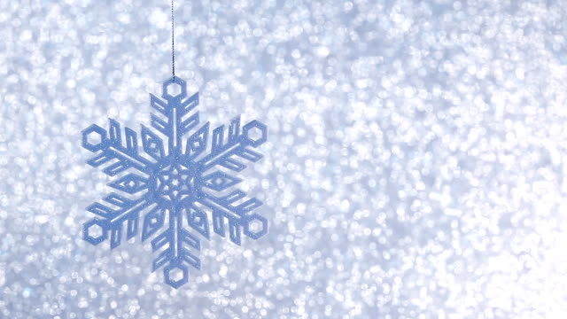 shiny blue christmas snowflake on defocused background video