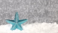 shiny blue christmas star on defocused background video