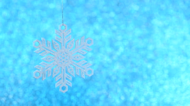 shiny christmas snowflake on defocused background video