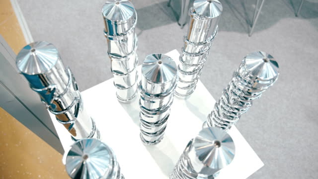 Shiny chrome Archimedean screws for different types of work video