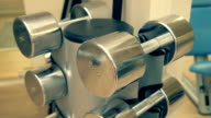 Shiny chrome dumbbells in the rack in the gym video
