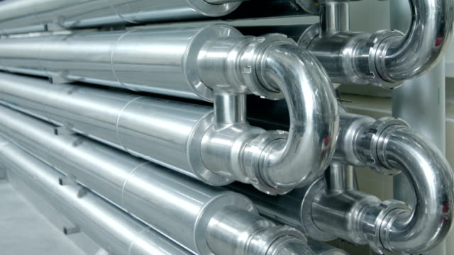 Shiny metal pipes in industrial building video